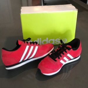 New red Adidas jogger shoes.